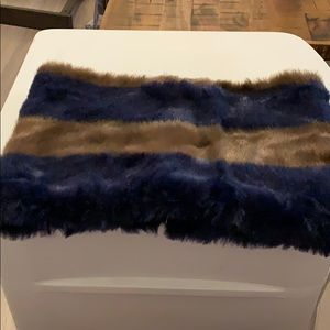Super soft faux fur muff. Looks adorable on